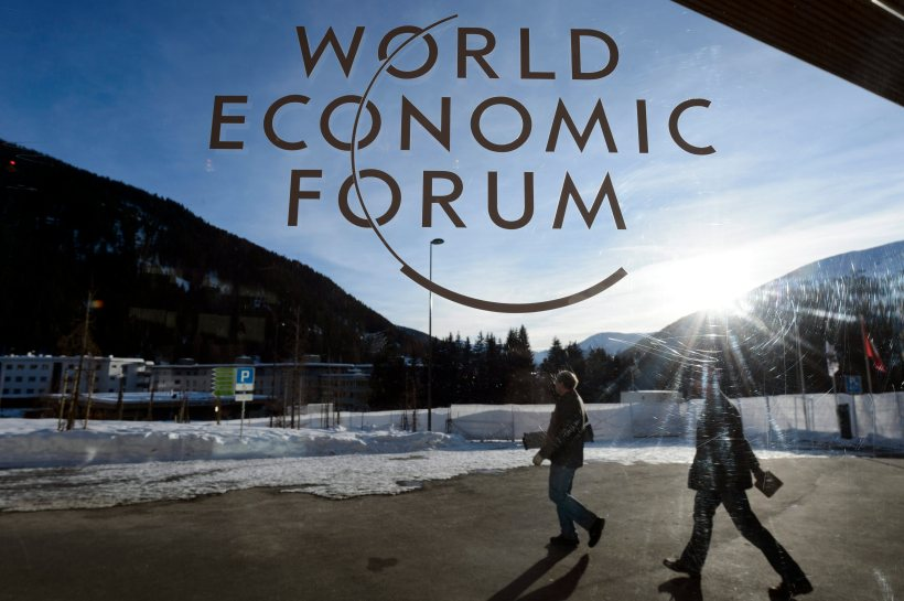 Participants leave the Congress Center the last day of  the 43rd Annual Meeting of the World Economic Forum, WEF, in Davos, Switzerland, Saturday, Jan. 26, 2013. (AP Photo/Keystone/Laurent Gillieron)